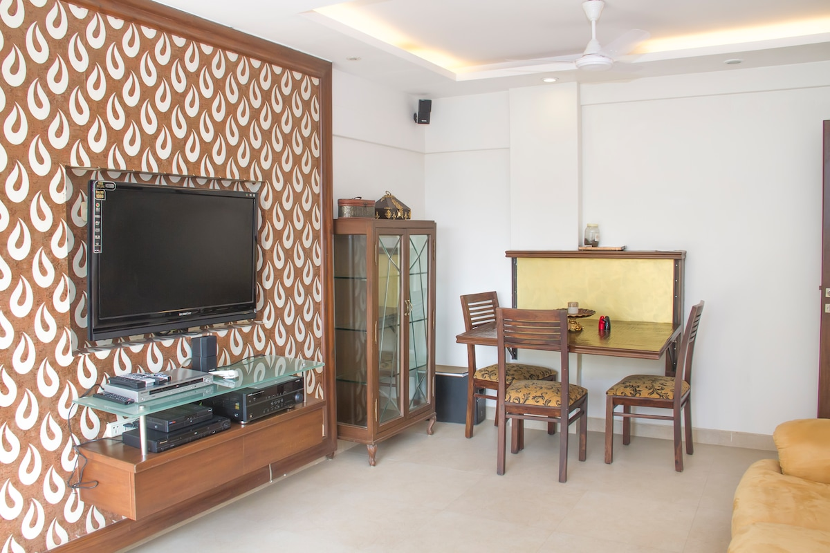 Living Room - Big LCD TV, Satellite Cable, Surround Music System 5.1, Glass Shelf, 3 Seat Table.