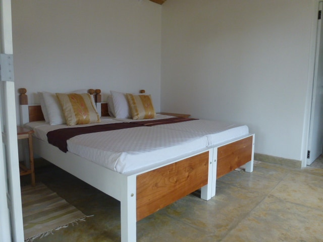 Twin beds in one of the garden chalets.