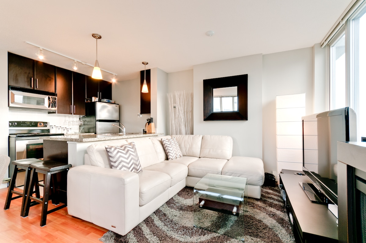 Plush leather sectional and open kitchen