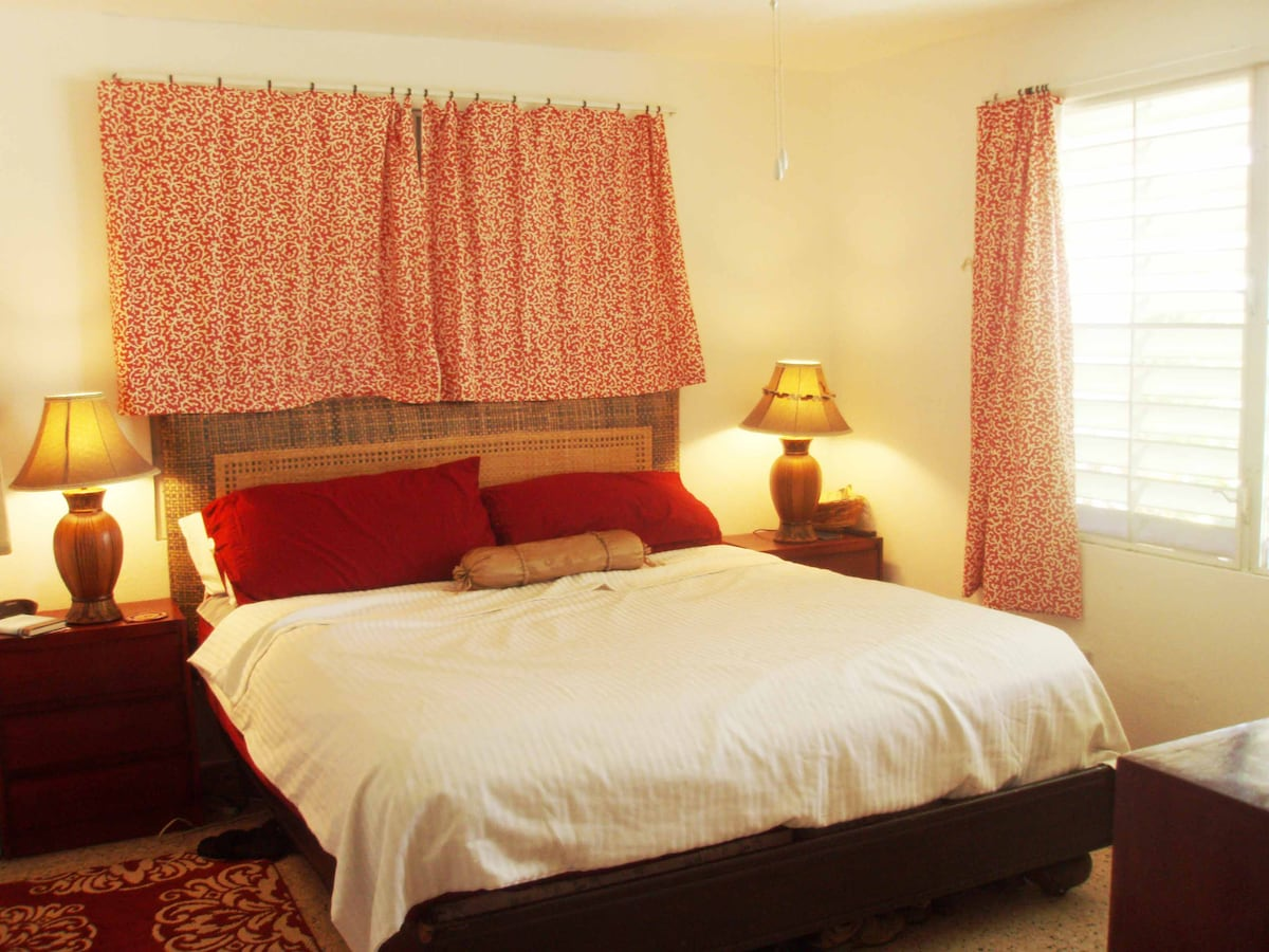 First Bedroom: the red room -- all rooms have a minimum of 4 windows for those famous trade winds