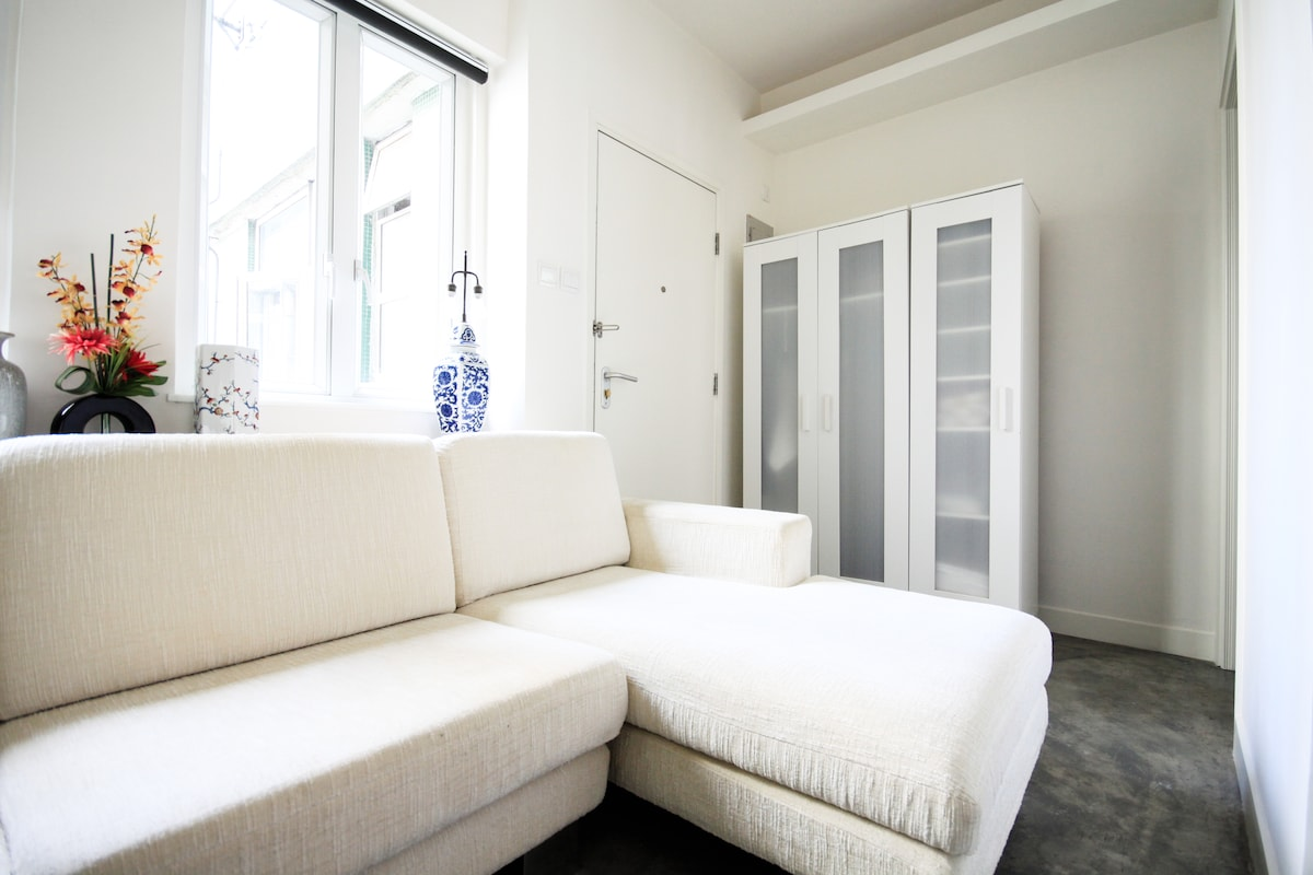 Spare and Sunny -- enjoy the view over Soho and relax on the long sofa from the moment you enter...