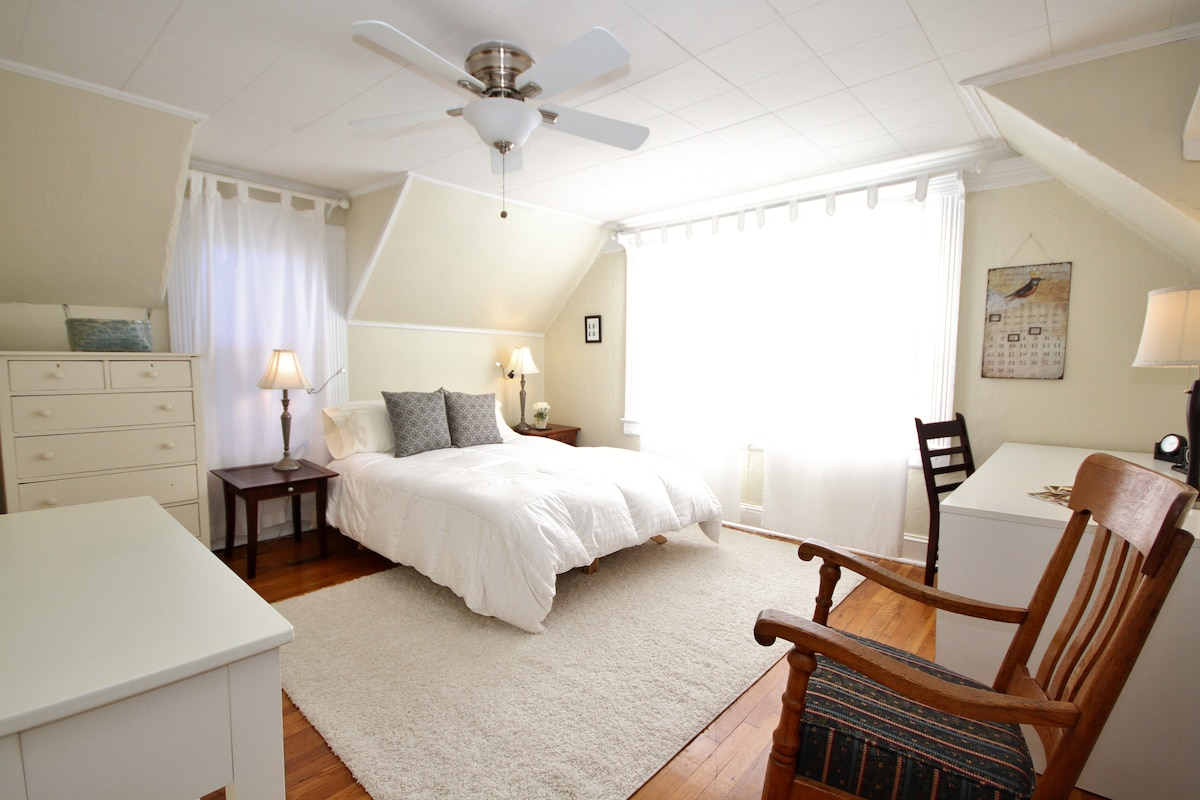 The bedroom is light filled and wrapped in tranquil colors.