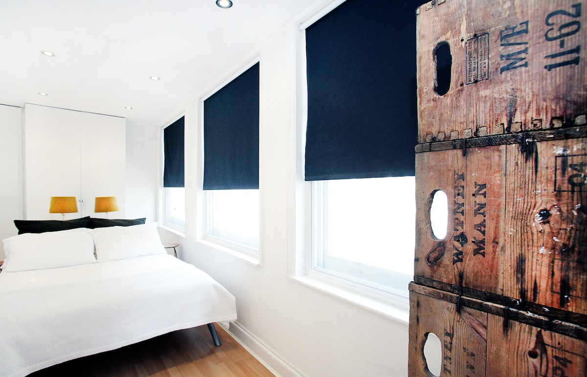 Bedroom with blackout blinds.