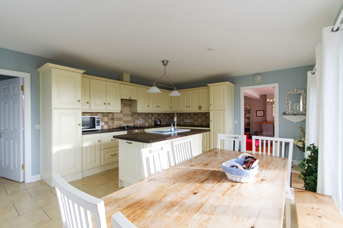 Plenty of room for up to 10 guests sharing a meal in the kitchen