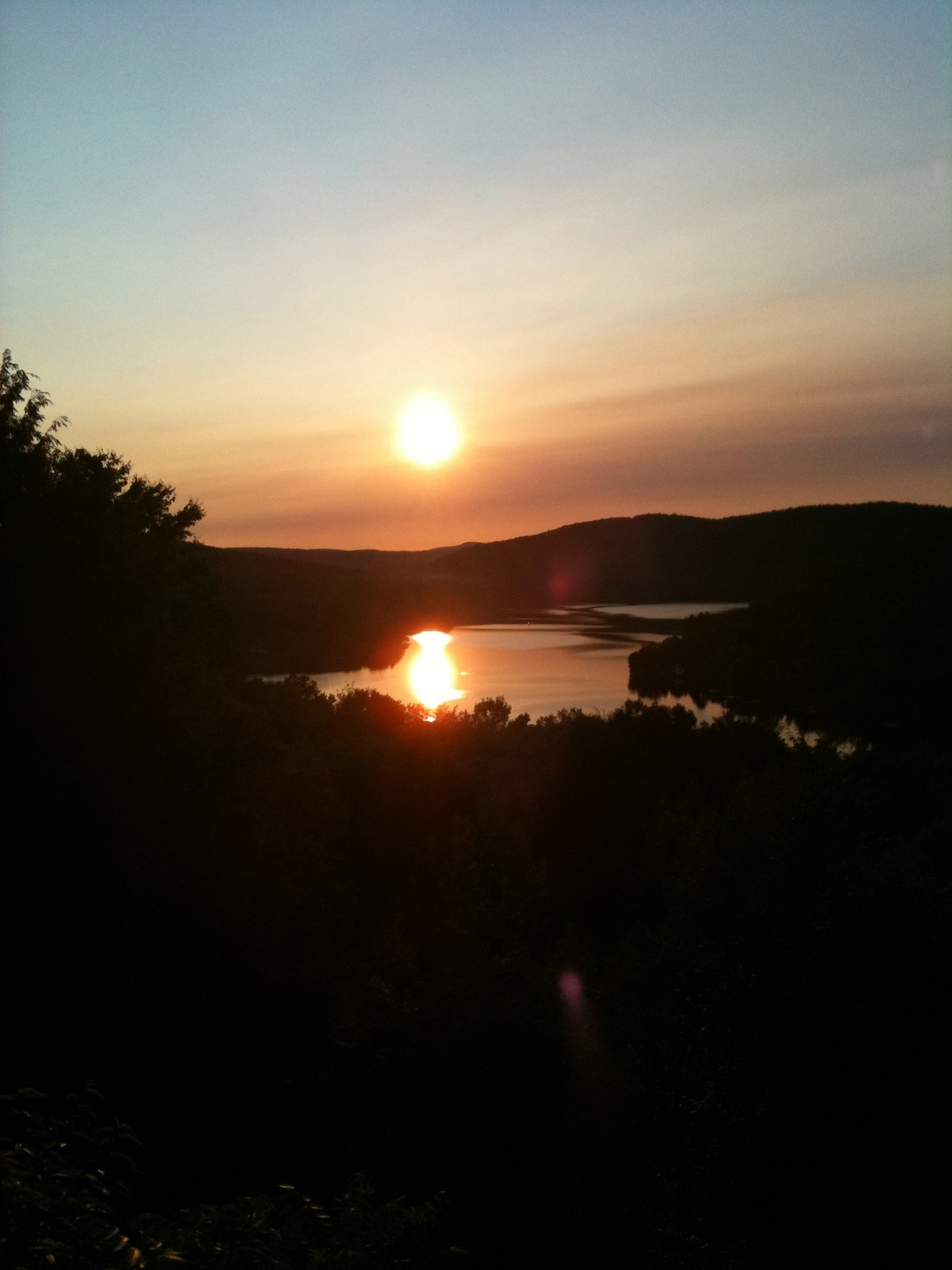 Watching the sun set from our patio after a wonderful day in Tremblant, Quebec