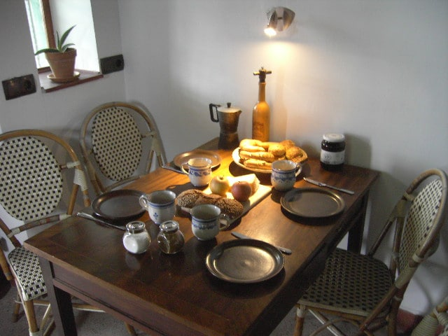 Dining table inside the kitchen with italian terazzo floor
