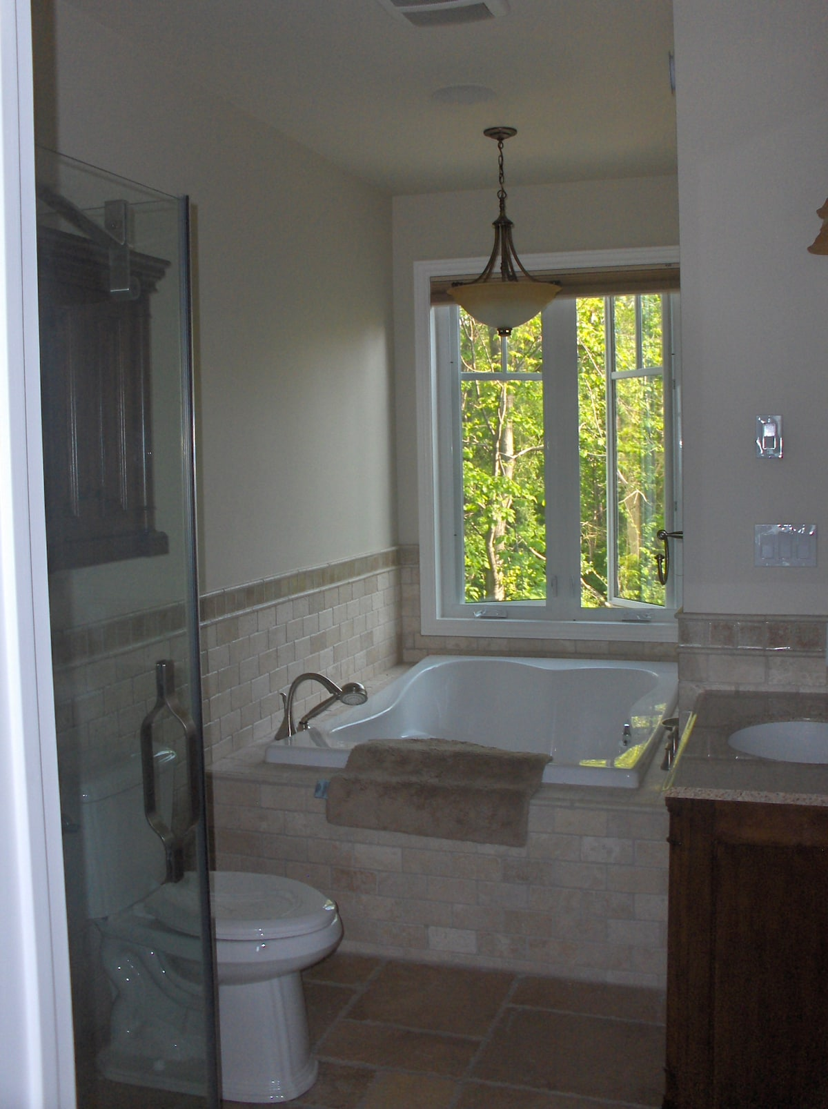 Master bathroom with double jet tub and glass shower