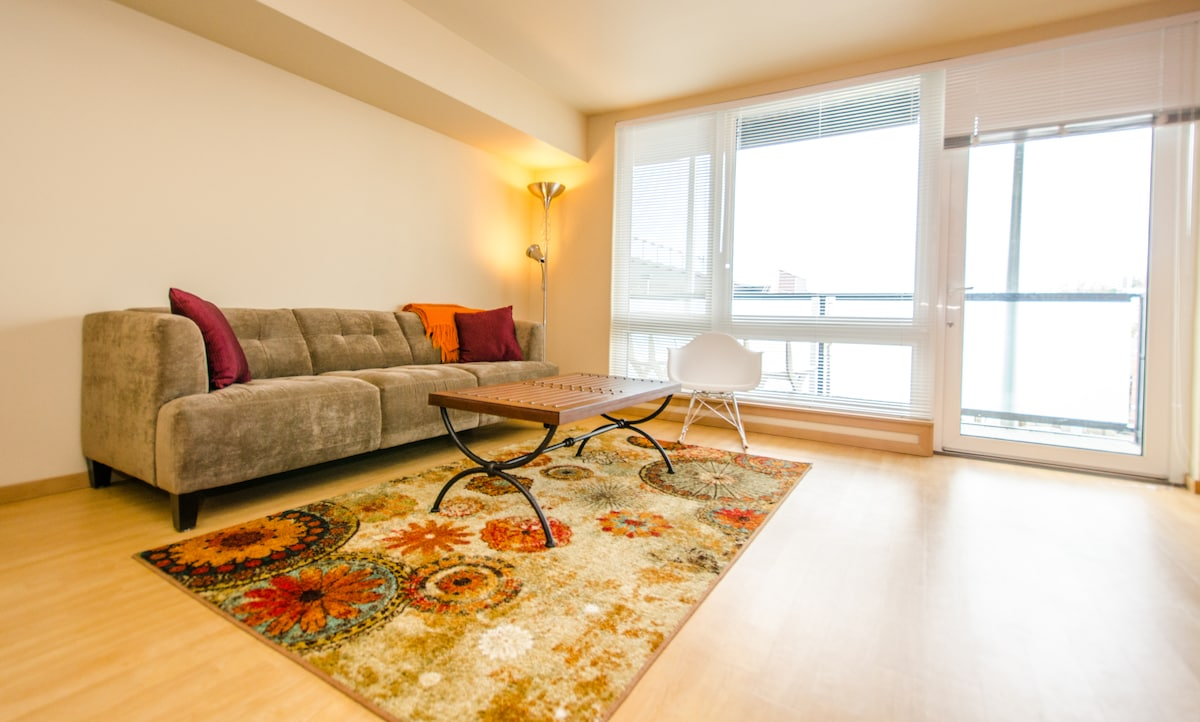 The living room opens to a private patio - with lower queen anne hill view!