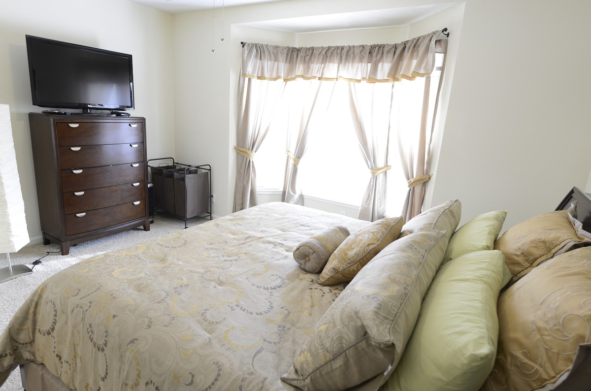 "Master bedroom with King bed and 50"" TV"