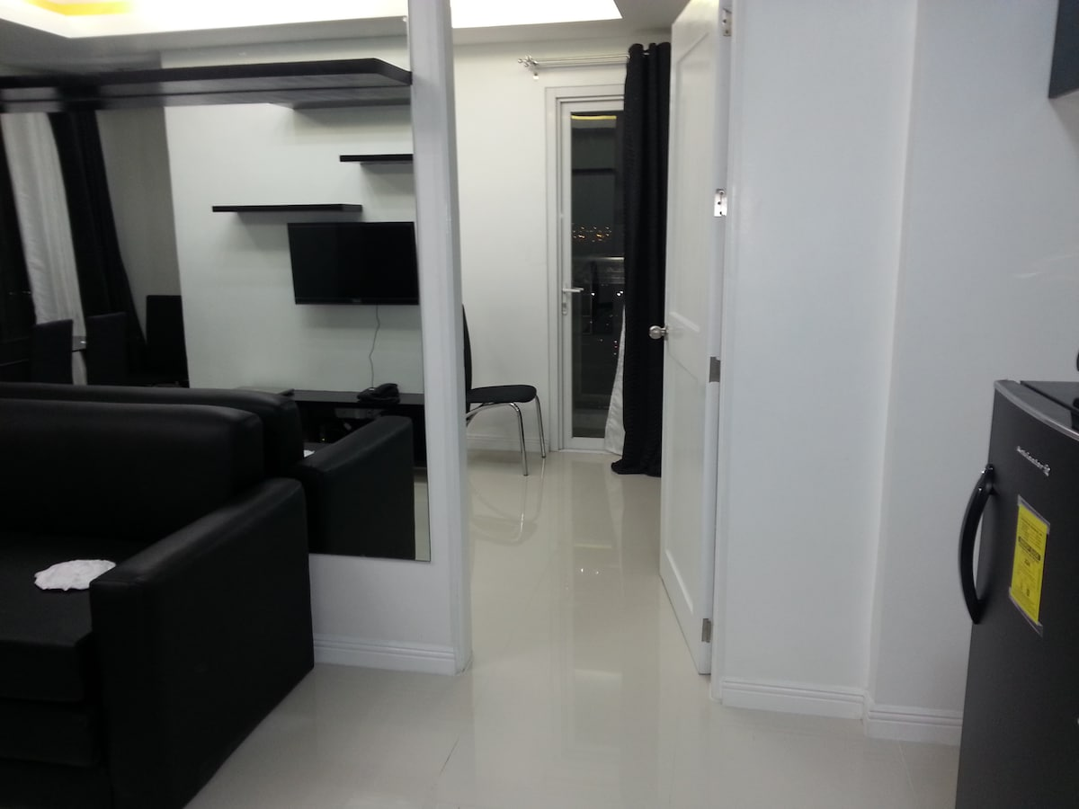 part of the living room and the door to the bedroom