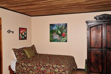 Queen bed, local artwork and an armoire with a lock box, extra towels, blankets and more.