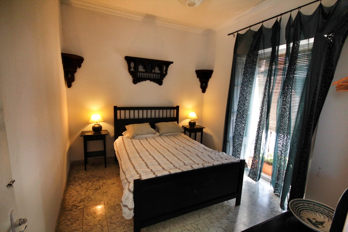 Bedroom with double bed, balcony onto the street