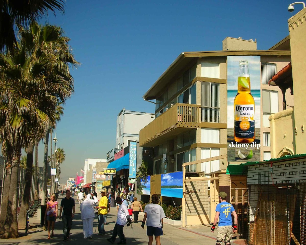 View of building from boardwalk (building has the Corona mural)