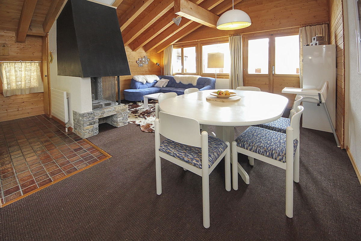 High chalet-style wooden ceilings and a great view towards the mountains.