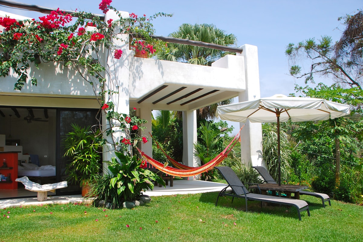 Enjoy the hammocks or the lounge chairs in the garden