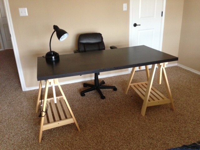 Office table, leather office chair and table lamp