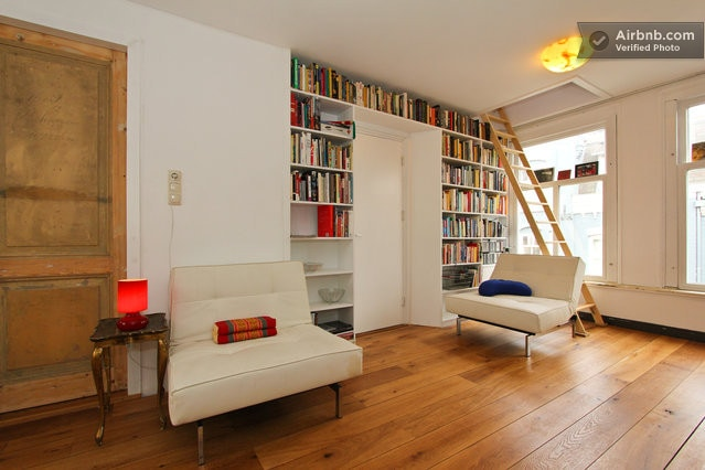 Livingroom with ladder to attic bedroom