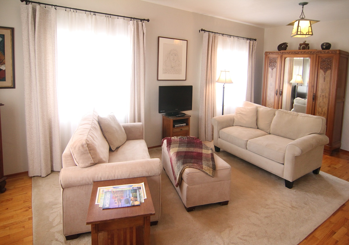 The love seat on the left opens to a twin bed.