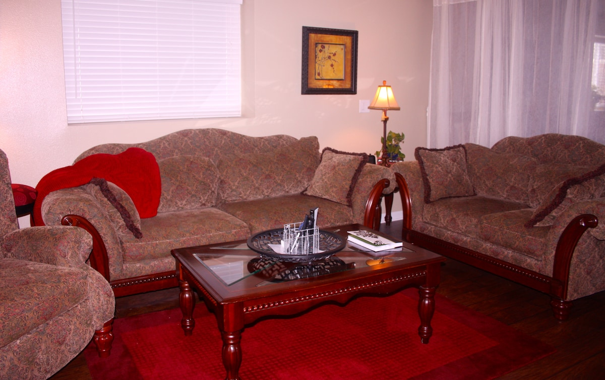 Couch, loveseat, recliner and coffee table in the suite.