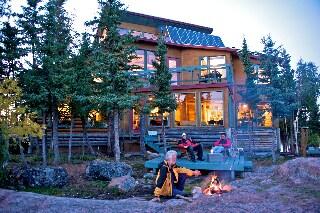 enjoying a camp fire outside the main lodge.
