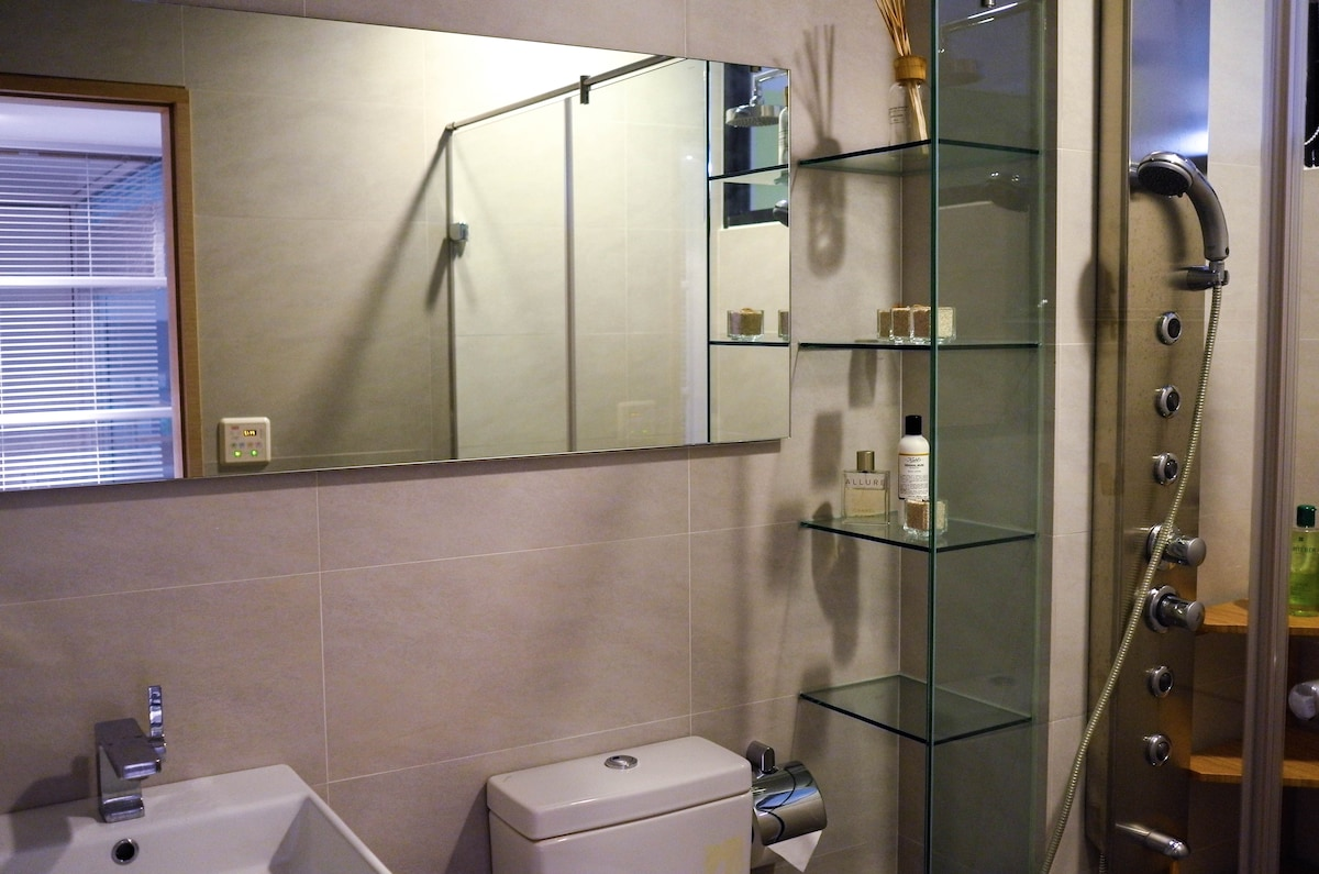 Climate and humidity-controlled bathroom with rain shower and body massage functions.