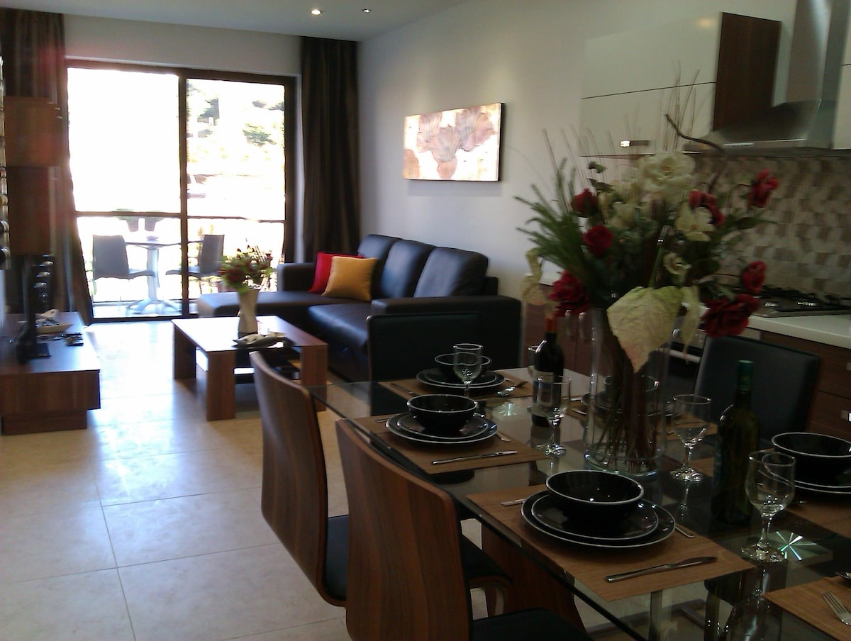 Dining and living area having sofa bed (sleeps 2). Balcony overlooking valley