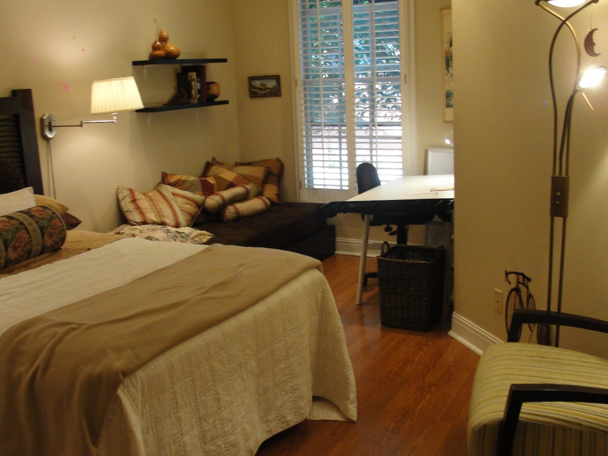 The guest bedroom is big enough to have its own couch and a work desk.