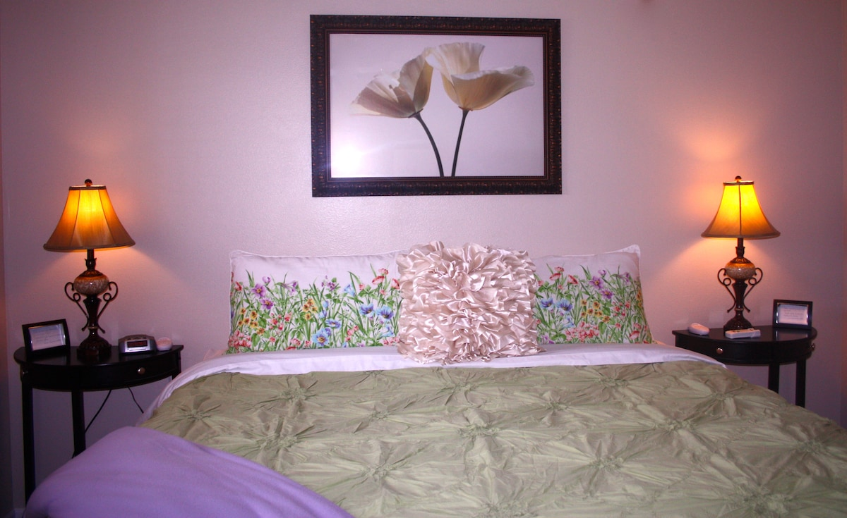 King Size Room with dual controlled, heated mattress, higher end linens and ceiling fan for your comfort.