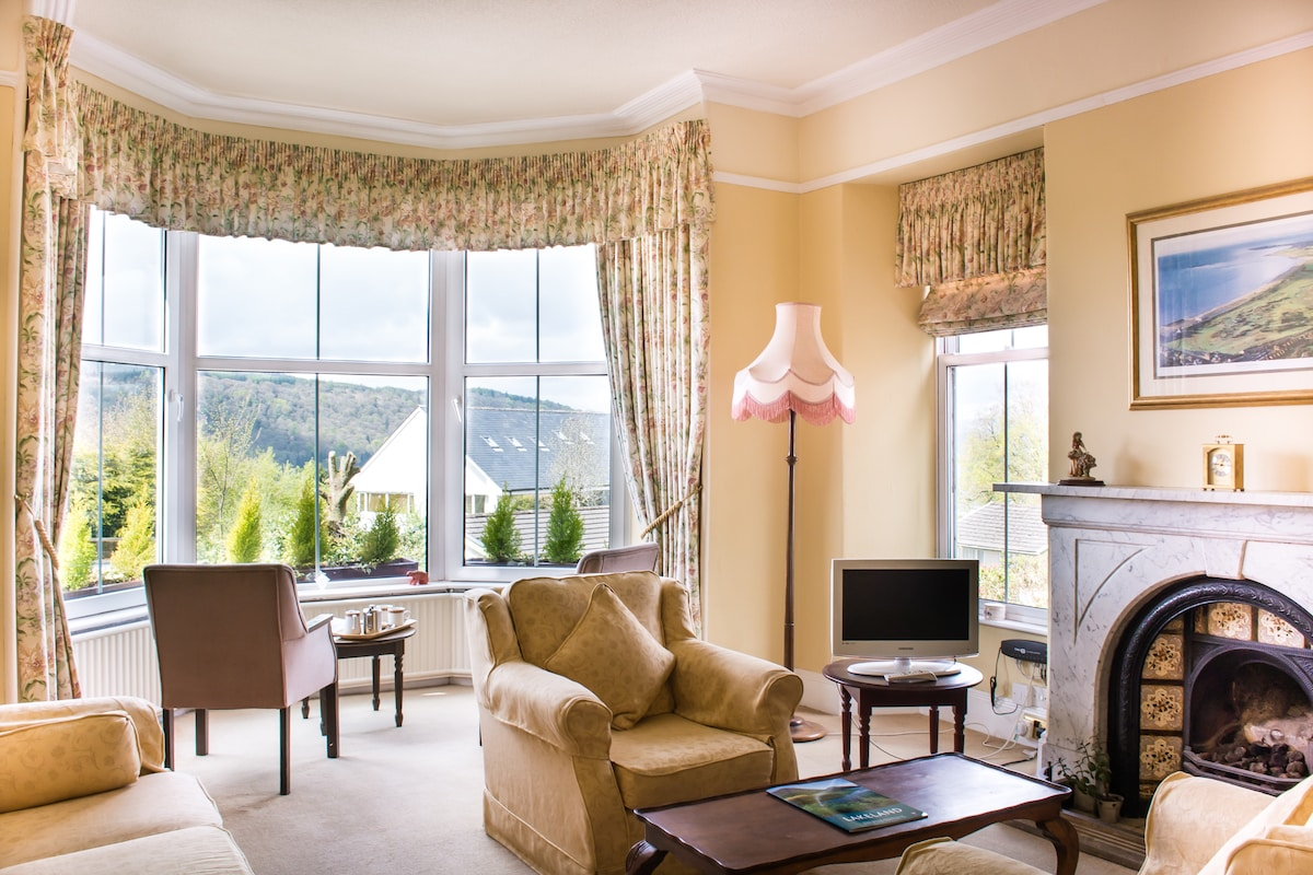 This is our lounge at Blenheim Lodge. Light and airy, our guest lounge is a comfortable place to watch TV, read a book, chat, have a cuppa or . . . even snooze!