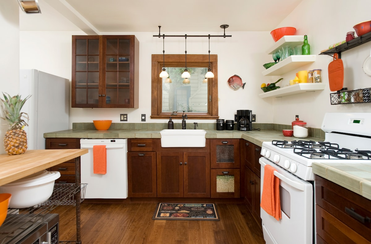 The kitchen is new, and clean and cute.