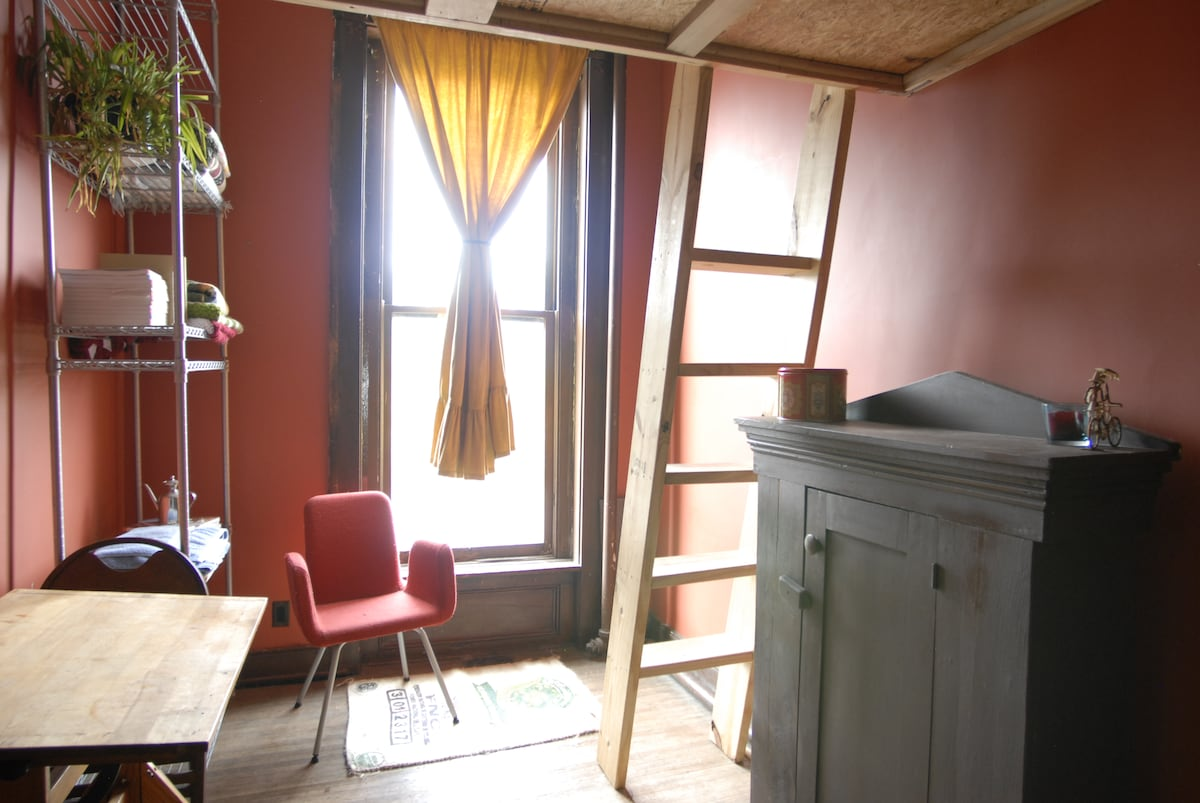 This cabinet is no longer here, but there is a closet in the room.