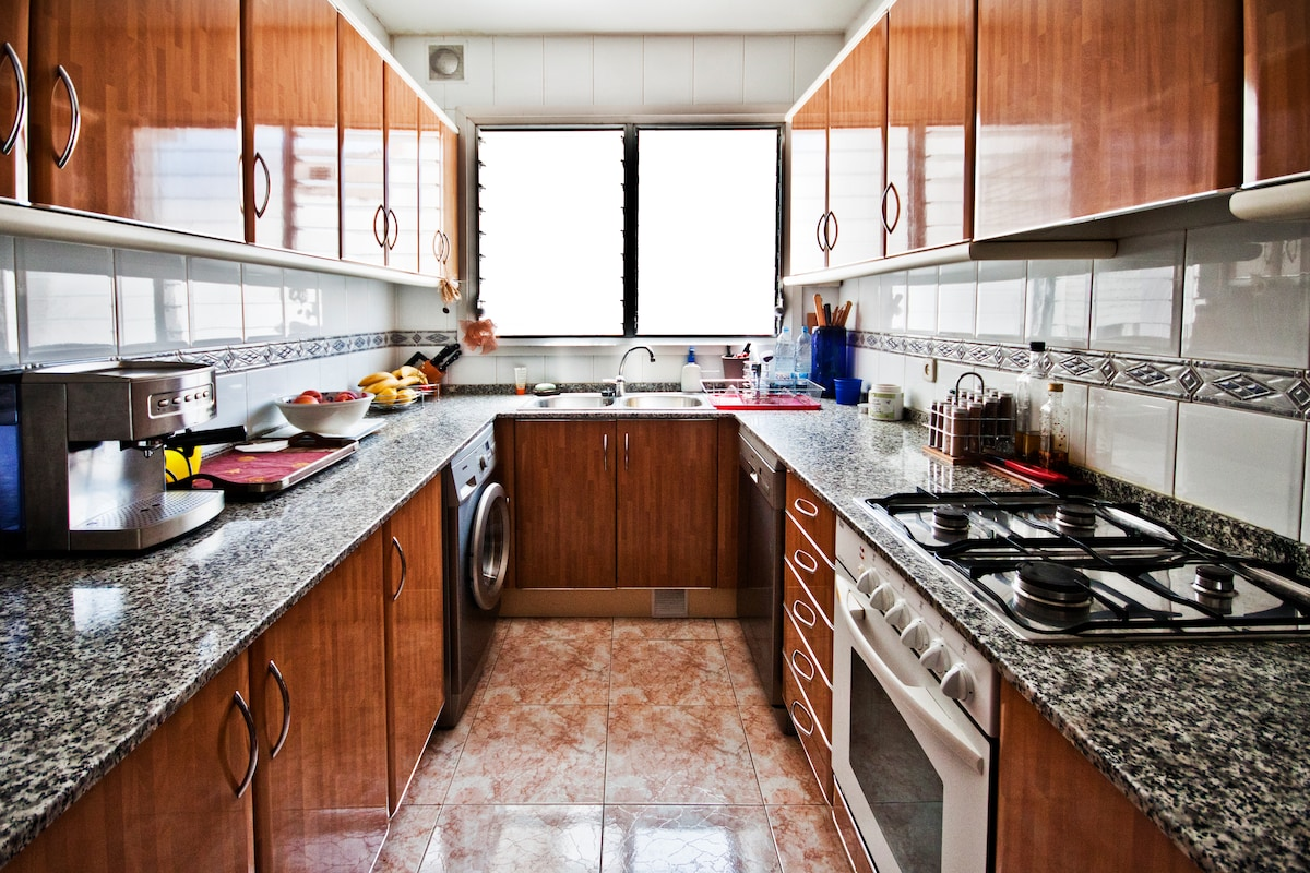 The kitchen, with all amenities, dishwasher, laundry and dryer.