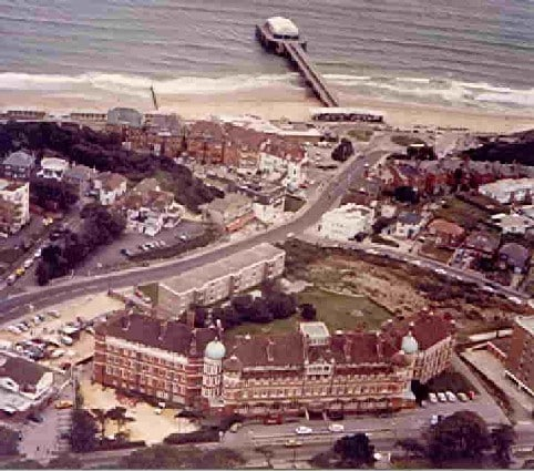 An old aeial view showing how close the building is to the beach and pier.