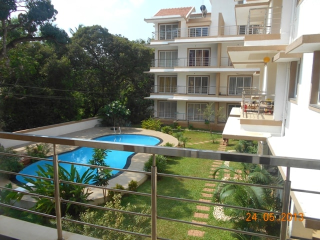 The Living room balcony overlooks the pool and the gardens.... tempted to jump right in?