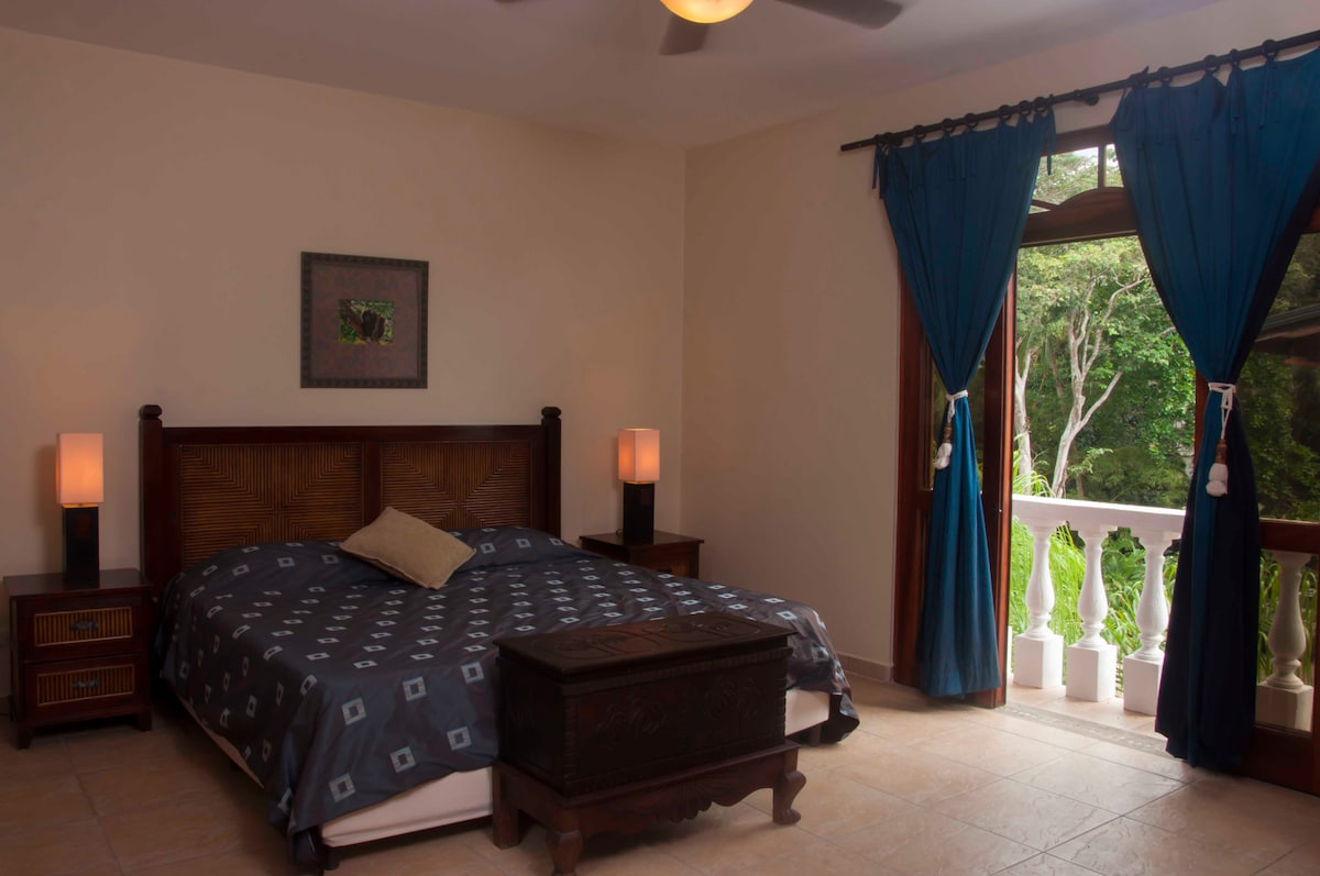 Second bedroom with gorgeous view of the surrounding gardens