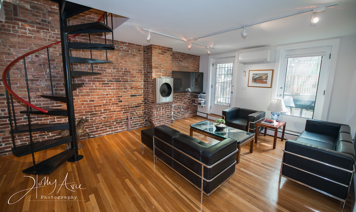 """Check Guidebook Then note Spiral, FireFeature, Samsung 55""""LED SMART TV, LR w Bonsai and LeCorbusier Architectural Furniture & door to bridge parking."""