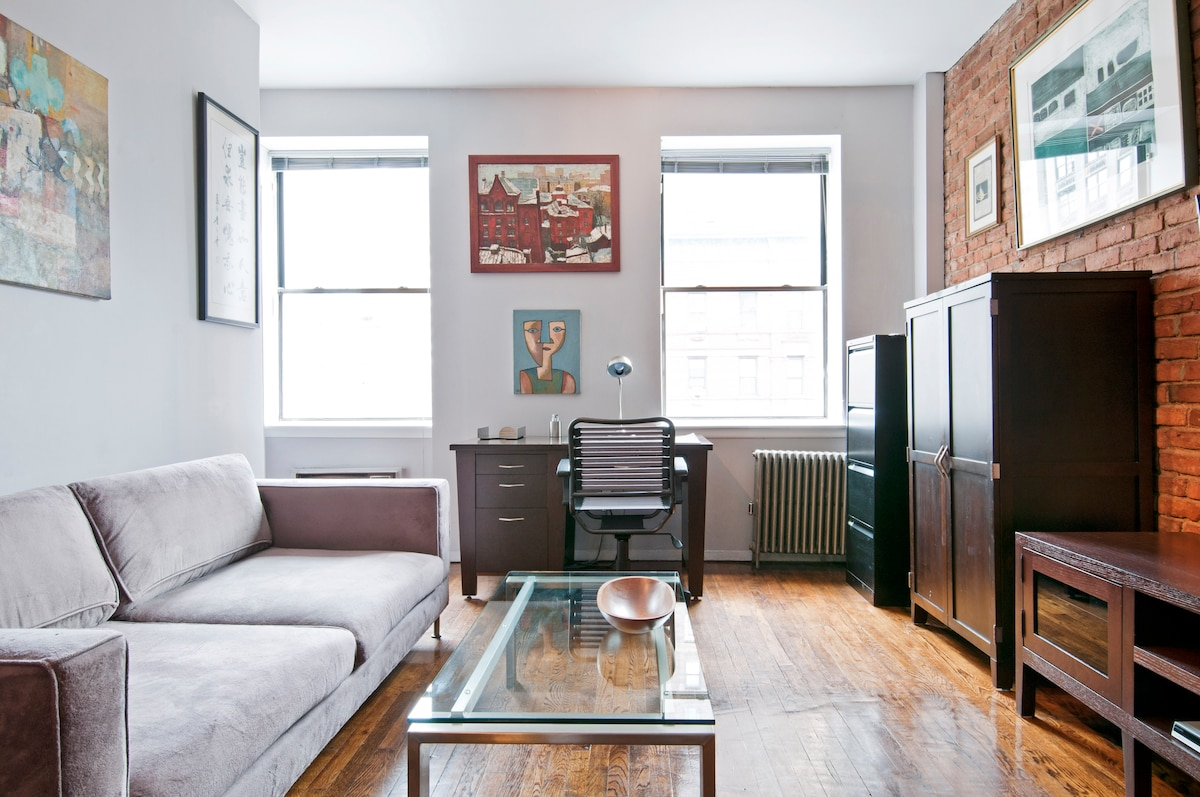 Modern two-room home with comfortable, fully-decorated living room where you can rest, relax and entertain.