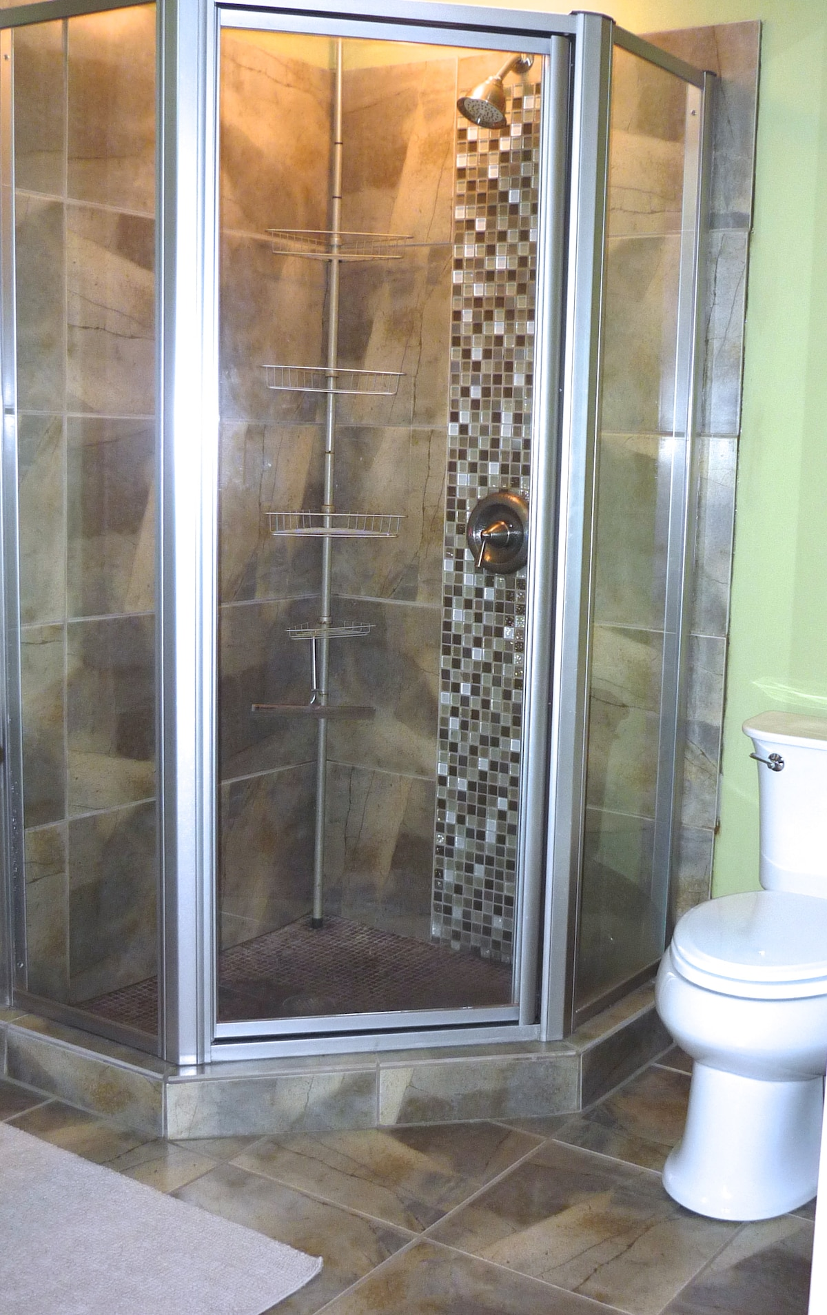 This private master bath is modern, clean and convenient.  Please note: the bathroom has a privacy curtain but no door.