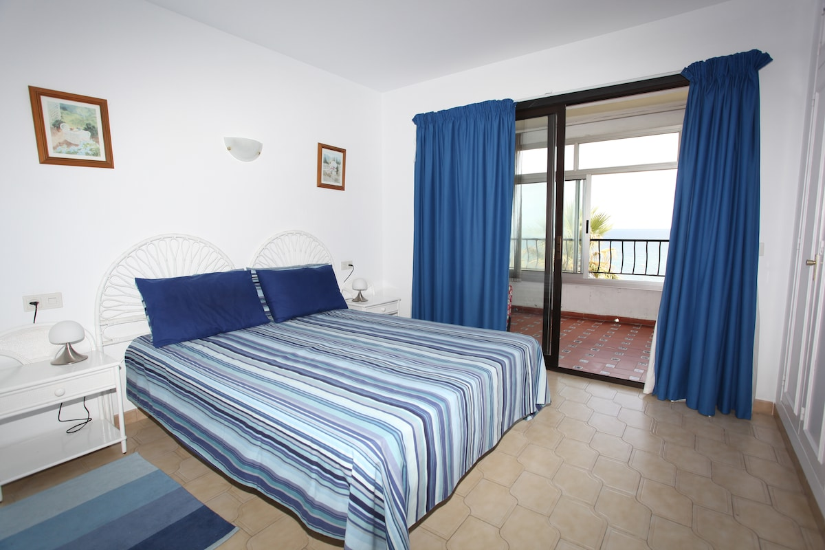 Lovely airy main bedroom with double bed.