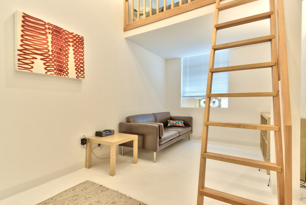 studio #7 is split into two levels, with a bed loft above.