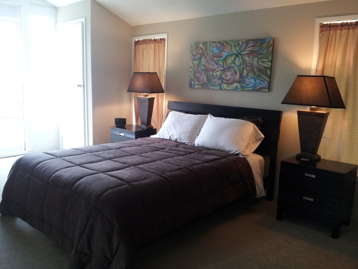 The spacious master bedroom has a bathroom en suite and a private balcony.