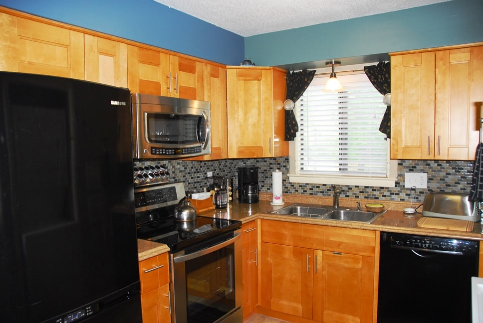 The brand new kitchen with solid wood cabinets, new high end appliances and lots of amenities for the gourmet cook or fast food guru.