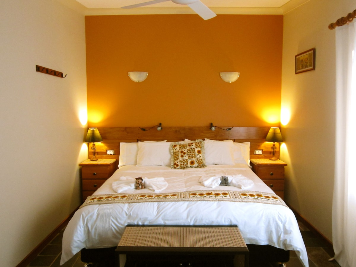 The Sunflower Room with your comfy KING BED waiting for you.  This bed can be converted to a Twin Share.