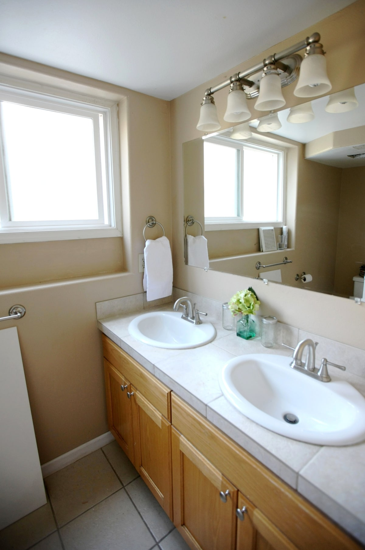 The bathroom has two sinks and shower room has a separate door, which makes sharing this space easy and convenient.