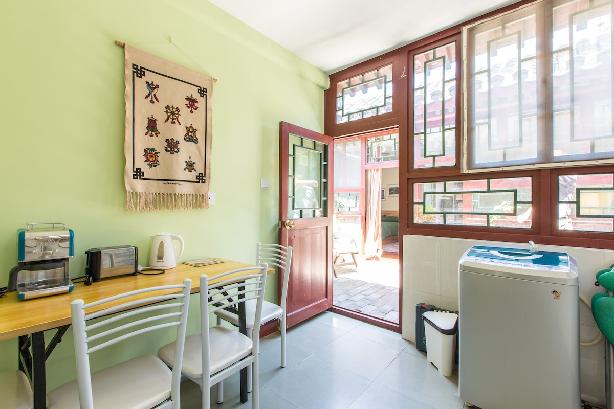 Our fairly spacious kitchen with a table that is easy to move outside for courtyard dinners.