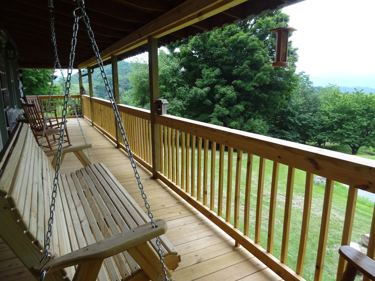 A six-foot porch swing and rocking chairs are waiting for you to come relax and watch the birds