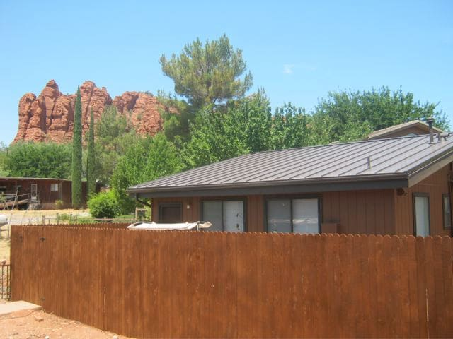 Exterior of cottage with Apache Butte in background.