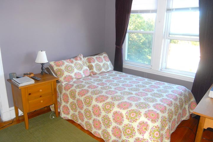 Private bedroom with full size bed and fantastic view of Boston.