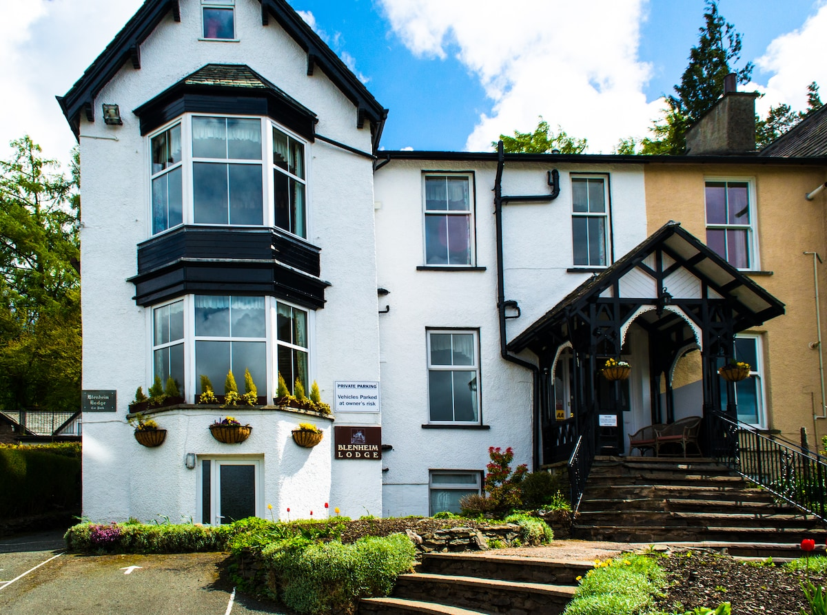 Blenheim Lodge is a Victorian guesthouse built in 1868, full of character and quirky rooms that overlook Lake Windermere and the fells.