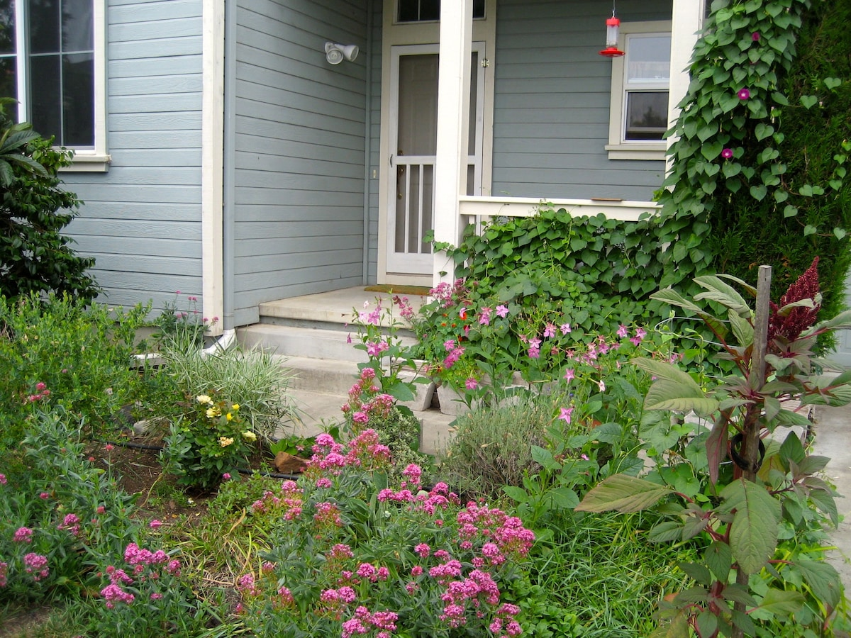 Front porch entry, with inviting garden pathway, and sensor lighting.